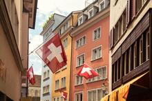 Picturesque Old Town Street With Swiss Flags, Zurich, Switzerland