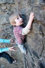 Young Boy Climbing Rock