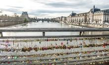 Love Padlocks On Bridge Over Seine River, Paris, France