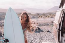 Smiling Woman With Surfboard By Vintage Camper Van