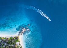 Aerial View Of Motorboat Sailing Near Shore Of Komodo Island, Nusa Tenggara Timur, Indonesia