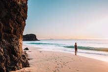 Woman Watching Sunset From White Sand Empty Beach, Lanzarote, Canary Islands, Spain