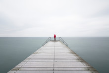Person Standing At End Of Pier...