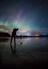 Ice Hockey Under Aurora Borealis