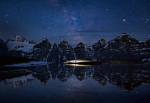 Night Time Reflecting In Minnestimma Lake, Banff, Alberta, Canada