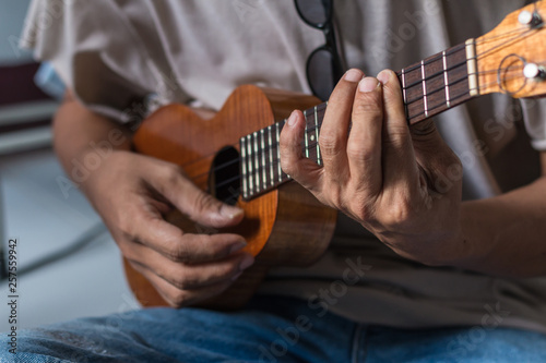guitar, playing, young, hand, men, handsome, human, acoustic, music, practicing, finger, instrument, sound, musician, musical, string, guitarist, lifestyle, play, background, adult, caucasian, white,  - 257559942
