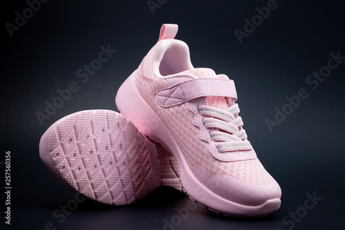 296a79be37b7d Pair of unbranded pink color sport or running shoes on a black background