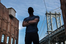 Anonymous City Hero Athlete In Good Physical Shape With Arms Crossed Pose On City Street