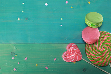 Colorful lollipops on wooden background. macaron dessert. Tasty candies on table on wooden background