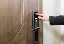 Yong Man Or Woman Push Fingers Down The Electronic Control Machine To Access The Door. Modern Lock. Scanning Finger