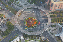 Aeriel View On Pedestrian Circle Bridge At Shanghai Pudong. Every Day Thousands Of Tourists Visit The Bridge To Take Photos Of The Famous Shanghai Skyline.