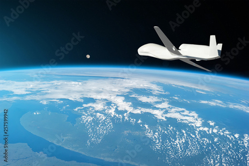 Unmanned aircraft flying in the upper atmosphere, the study of the gas shells of the planet Earth, moonrise on the horizon Fototapet