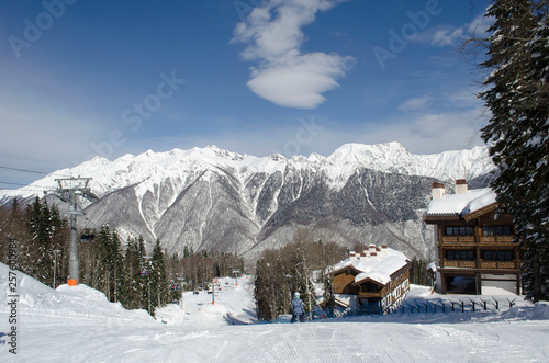 Scenic view of mountain slopes and apartments at ski resort Laura Russia Wallpaper Mural