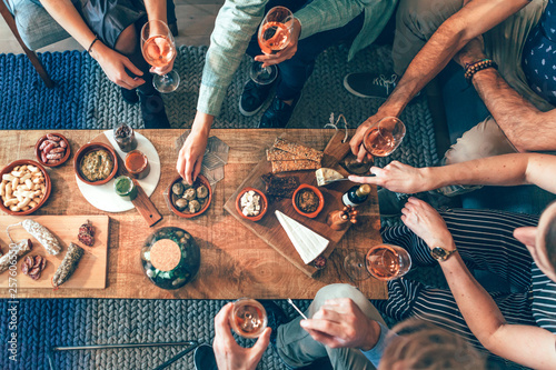 top view of a group of people around a table enjoying food and friendship Wallpaper Mural