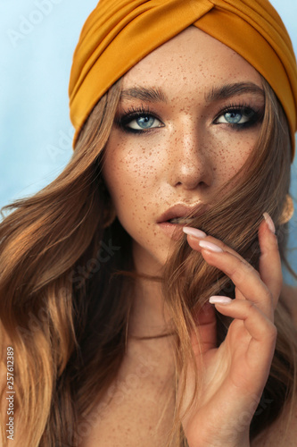 Canvas-taulu portrait of beautiful young woman with brown hair and freckles face