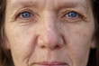 Cropped face of a blue-eyed middle-aged woman