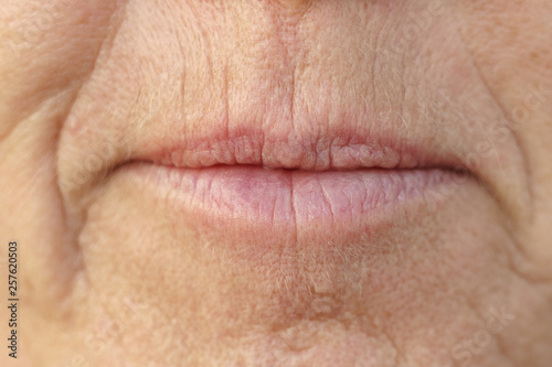 Fotografie, Obraz  Extreme Closeup on the mouth of a middle-aged woman