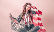 Patriotic Girl With The Flag Of America On A Colored Background