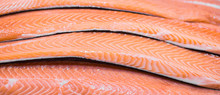 Sliced Raw, Not Cooked Salmon, Red Fish, Lying In The Ice On The Counter In The Supermarket