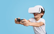 canvas print picture Excited kid in VR headset playing game