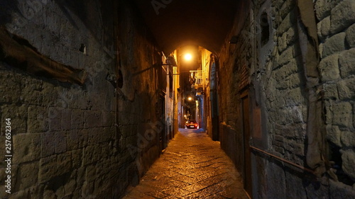 Fototapeten Schmale Gasse Night view of the buildings alleys, side streets, in historical center of, NAPLES, ITALY