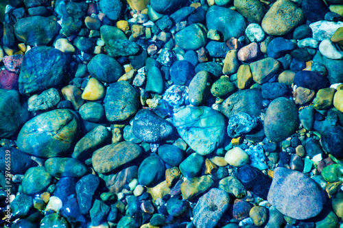 Photo sur Toile Zen pierres a sable Sea stones in the sea water. Pebbles under water. The view from the top.