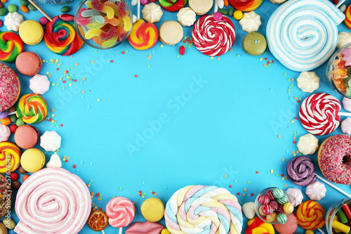 Poster Confiserie candies with jelly and sugar. colorful array of different childs sweets and treats on blue