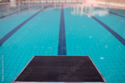 Starting blocks in row by the swimming pool, selective focus ...