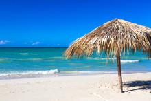 Straw Umbrella On Empty Seasid...