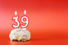 Thirty Nine Years Birthday. Cupcake With White Burning Candle In The Form Of Number 39. Vivid Red Background With Copy Space