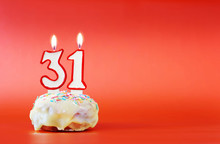 Thirty One Years Birthday. Cupcake With White Burning Candle In The Form Of Number 31. Vivid Red Background With Copy Space