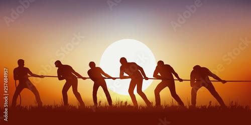 Foto Concept de la combativité avec un groupe d'hommes qui unissent leurs forces au tir à la corde, pour battre leurs adversaires