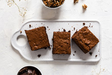 Chocolate Brownie Cake, Dessert With Nuts On Dark Background, Directly Above, Copy Space