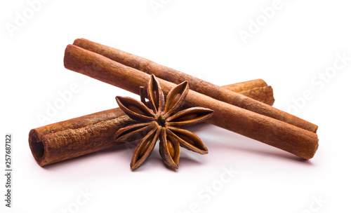 Leinwand Poster cinnamon stick and star anise on white background