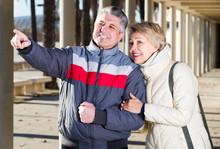 Mature Husband Points To Something Interesting