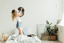 Beautiful Smiling Young Woman Holding Scottish Fold Cat In Modern Bedroom With Copy Space