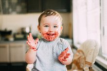 Portrait Of A Child Smiling With A Dirty Face In Jam