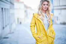 Blonde Girl In A Yellow Raincoat