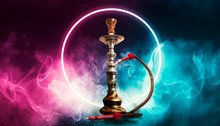 Hookah Smoking On A Dark Abstract Background. Hookah On A Concrete Background, Neon Lights, Blurred Night Lights, Bokeh