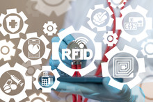 Doctor Or Druggist Uses Smartphone Sees On A Virtual Screen Of The Future And Touches The Icon: Rfid Radio Signal. RFID Radio Frequency Identification Communication Marketing Health Pharmacy System.