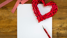 Mock Up Clean Sheet Of Paper With Red Pen, Straw Heart And White And Red Quadrille Ribbon On Old Wooden Rustic Background. Happy Fathers Day Concept. Copy Space For Text Or Design.