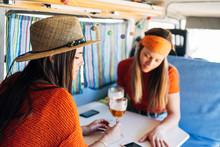 Two Young Women Using Smart Mo...