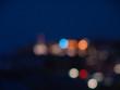 Night city lights bokeh of defocused vivid colorful circles of light in blue hour