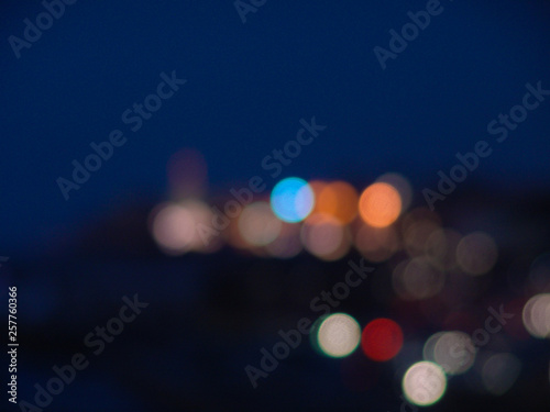 Fototapeta Night city lights bokeh of defocused vivid colorful circles of light in blue hour obraz na płótnie