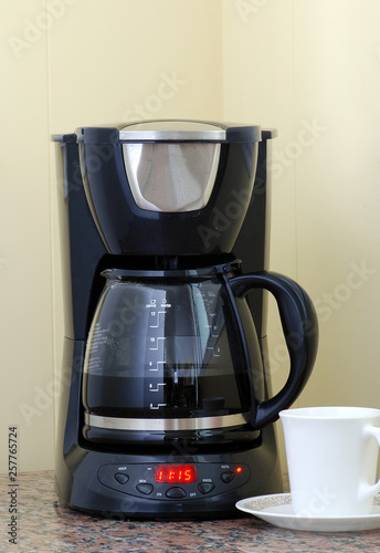 Fotografie, Obraz  Hot Black Coffee in Glass Pot against Neutral BG with Copy Space includes Cup an