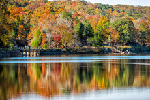 Great Falls Trees Reflection During Autumn In Maryland Colorful Yellow Orange Leaves Foliage By Famous Billy Goat Trail People Walking Hiking On Bridge