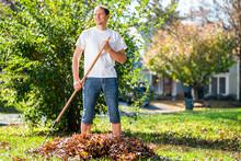 Young Man Homeowner In Garden ...