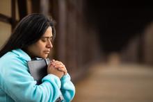 Hispanic Woman Sitting On A Br...