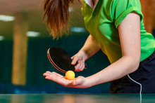 Black Ping Pong Paddle And Ball In Female Hands Close. Serve The Ball In Table Tennis