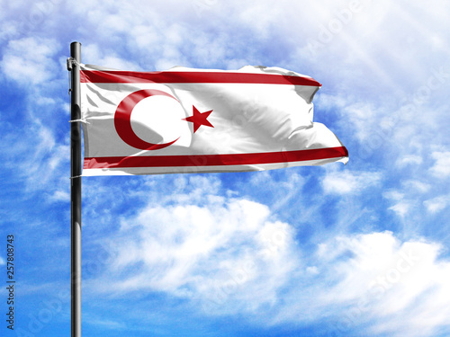 Fotografia  National flag of Turkish Republic of Northern Cyprus on a flagpole in front of blue sky